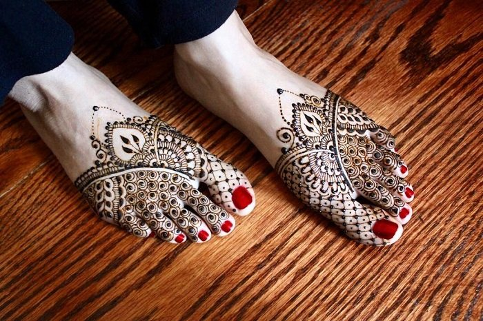half foot with stunning intricate tiny flowers and circles foot mehndi design